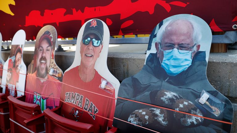 Cut-outs of fans, including the viral photograph of Bernie Sanders wearing mittens, fill some of the seats to maintain social distancing at the Super Bowl