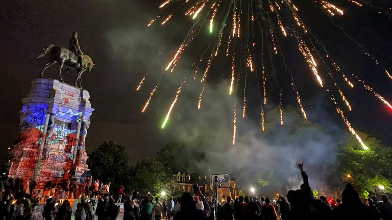 Fireworks explode over the statue of Confederate General Robert E. Lee during an event to mark Juneteenth, which commemorates the end of slavery in Texas, two years after the 1863 Emancipation Proclamation freed slaves elsewhere in the United States, amid nationwide protests against racial inequality, in Richmond, Virginia, U.S., June 19, 2020. Mallory Noe-Payne via REUTERS MANDATORY CREDIT. MUST CREDIT MALLORY NOE-PAYNE. SENSITIVE MATERIAL. THIS IMAGE MAY OFFEND OR DISTURB TPX IMAGES OF THE DAY
