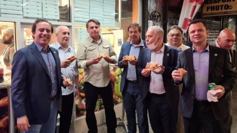 Mr Bolsonaro was seen with his team eating pizza in New York ahead of the summit