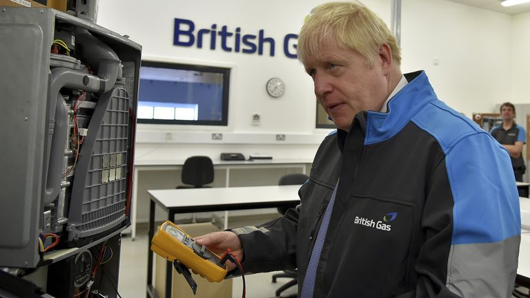 Boris Johnson hold a piece of testing equipment during a visit to a British Gas training academy in Leicestershire. Picture date: Monday September 13, 2021.