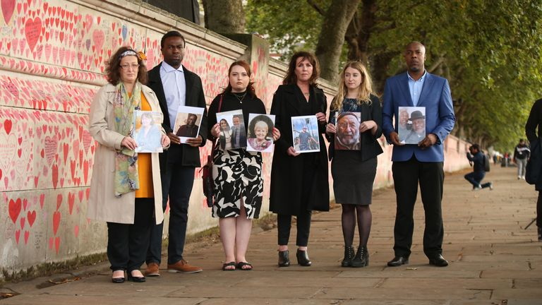 Bereaved people hold photos of loved ones lost to coronavirus (from left, with the names of those who died in brackets) Deborah Doyle (Sylvia Griffiths), Lobby Akinnola (Olufemi Akinnola), Hannah Brady (Shaun Brady/Margaret Brady), Fran Hall (Steve Mead), Jo Goodman (Stuart Goodman), Charlie Williams (Rex Williams), next to the Covid Memorial Wall on the embankment of the River Thames opposite the House of Parliament in central London. Picture date: Tuesday September 28, 2021.