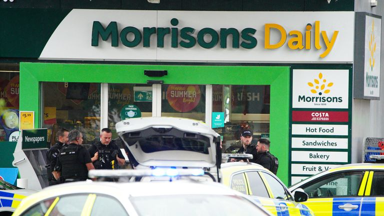 Bristol incident Armed police at the scene of an incident in Hengrove Way, Bristol, where a man armed with a knife is inside the shop of the petrol station. Staff members are uninjured within a safe room and in contact with officers. Picture date: Thursday September 9, 2021.