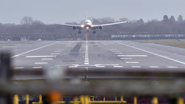A British Airways plane landing at Gatwick airport