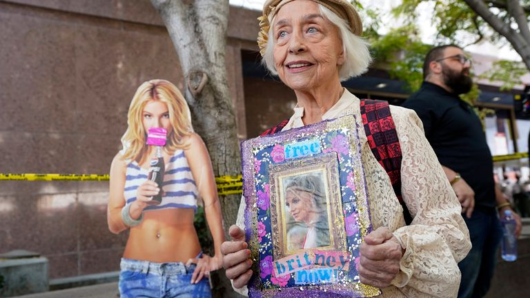 Britney Spears supporter Mona Montgomery demonstrates outside a conservatorship case hearing at the Stanley Mosk Courthouse on 29 September 2021. Pic: AP/Chris Pizzello