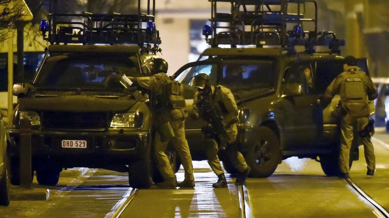 Four officers were injured in the 15 March raid. Pic: AP