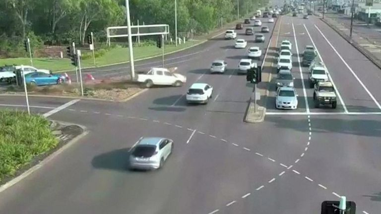Australian police captured dramatic footage of a white vehicle speeding unscathed across multiple lanes of traffic