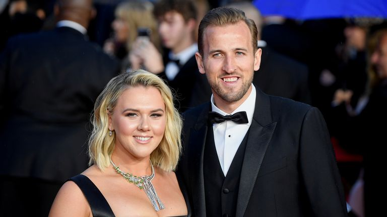 """Soccer player Harry Kane and his wife Katie Goodland pose during the world premiere of the new James Bond film """"No Time To Die"""" at the Royal Albert Hall in London, Britain, September 28, 2021. REUTERS/Toby Melville"""
