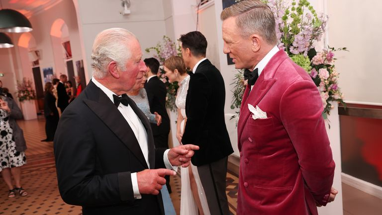 The Prince of Wales speaks with Daniel Craig upon his arrival for the World Premiere of No Time To Die, at the Royal Albert Hall in London. Picture date: Tuesday September 28, 2021.