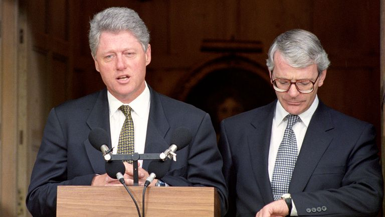 1994: British Prime Minister John Major checks his watch as American President Bill Clinton addresses the assembled media at Chequers, Buckinghamshire.