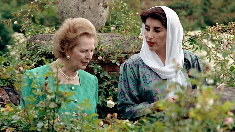 Palistani Prime Minister Benazir Bhutto and Prime Minister Margaret Thatcher in a rose garden at Chequers.