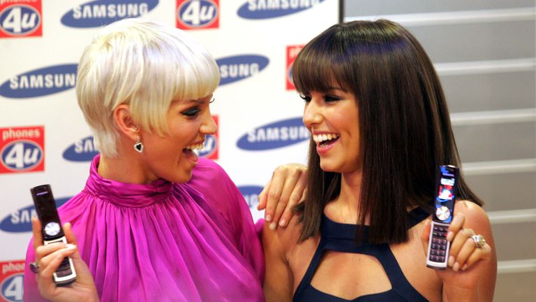 Sarah Harding And Cheryl Cole (tweedy) From Girls Aloud Are Pictured With The New Samsung Phone At Its Launch Today On London's Oxford Street.