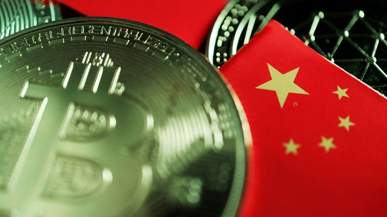FILE PHOTO: A Chinese flag is seen among representations of Bitcoin and other cryptocurrencies in this illustration picture taken June 2, 2021. REUTERS/Florence Lo/Illustration/File Photo