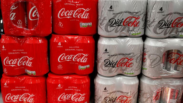 Multi can packs of Coca Cola and Diet Coke are seen for sale in a motorway services shop, Reading, January 25, 2019