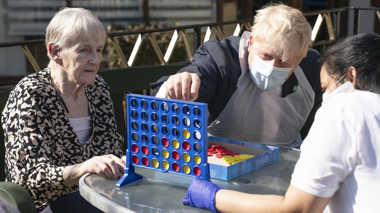 Social Care reforms Prime Minister Boris Johnson plays Connect 4 with resident Janet (left) and carer Lakshmi during a visit to Westport Care Home in Stepney Green, east London, ahead of unveiling his long-awaited plan to fix the broken social care system. Picture date: Tuesday…