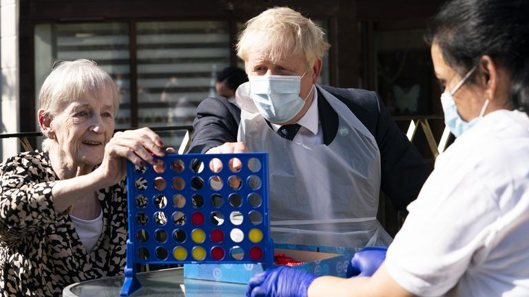 Pime Minister Boris Johnson plays Connect 4 with resident Janet (left) and carer Lakshmi during a visit to Westport Care Home in Stepney Green, east London, ahead of unveiling his long-awaited plan to fix the broken social care system. Picture date: Tuesday September 7, 2021. Paul Edwards/The Sun/PA Wire/PA Images