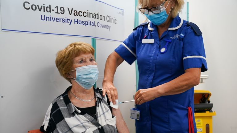 Margaret Keenan, the first person to receive the coronavirus vaccine in December last year, receives her booster jab at University Hospital Coventry, Warwickshire