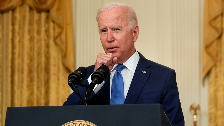 U.S. President Joe Biden clears his throat as he delivers remarks on the economy during a speech in the East Room of the White House in Washington