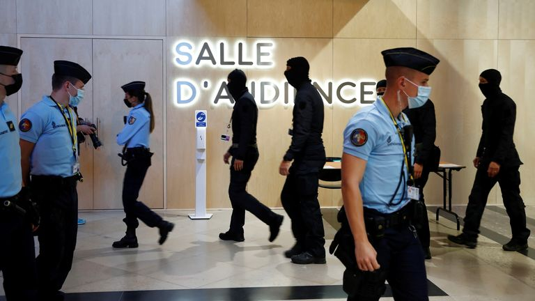 French Gendarmes and police secure outside the temporary courtroom set up at the Paris courthouse on the Ile de la Cite before the start of the trial of the Paris' November 2015 attacks, in Paris, France