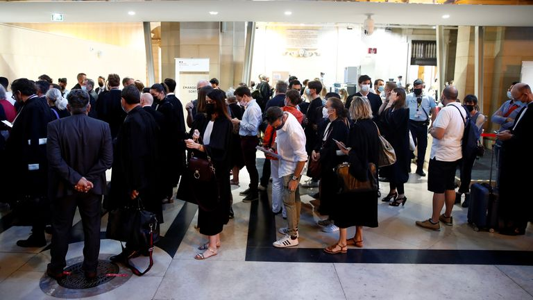 People arrive for the start of the trial of the Paris' November 2015 attacks at the Paris courthouse on the Ile de la Cite, in Paris, France, September 8, 2021. Twenty defendants stand trial over Paris' November 2015 attacks from September 8, 2021 to May 25, 2022, with nearly 1,800 civil parties, more than 300 lawyers, hundreds of journalists and large-scale security challenges. REUTERS/Gonzalo Fuentes