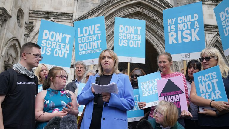 Maire Lea-Wilson speaking to the media at the High Court in London after Heidi Crowter lost a High Court challenge against the Government over legislation which allows the abortion of babies with the condition up until birth. Picture date: Thursday September 23, 2021.