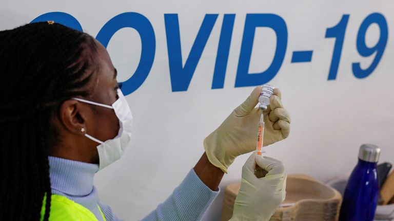 FILE PHOTO: A dose of AstraZeneca vaccine is prepared at COVID-19 vaccination centre in the Odeon Luxe Cinema in Maidstone, Britain February 10, 2021. REUTERS/Andrew Couldridge/File Photo