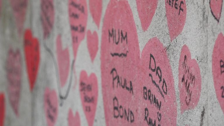A group of volunteers repaint the hearts - and add new ones as the number of deaths rise