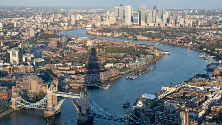 The Shard skyscraper casts a shadow as a tall ship sails down the River Thames towards an open Tower Bridge in London Thursday Sept. 16, 2021. In the background is the Canary Wharf financial district. (AP Photo/Tony Hicks) PIC:AP