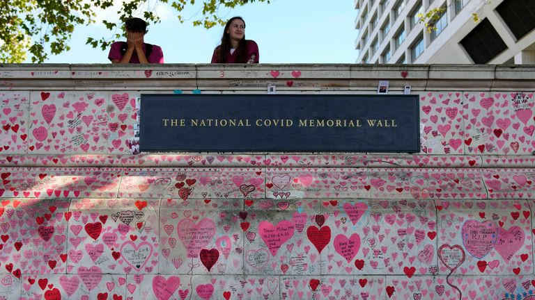 People rest at the National Covid Memory Wall in London, Thursday, Sept. 16, 2021 PIC:AP