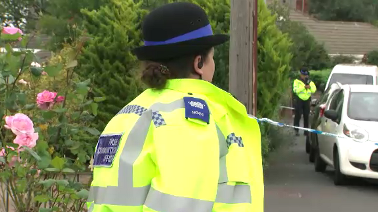 Police at the scene where a man in his 70s has died after a heavy load fell from a crane.
