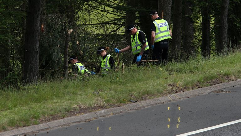 File photo dated 09/07/15 of police officers searching the scene at Junction 9 of the M9 near Stirling where John Yuill and Lamara Bell were discovered. Representatives from Police Scotland will appear at Edinburgh High Court on Tuesday to give evidence in the M9 death crash case. Issue date: Tuesday September 7, 2021.