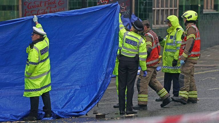 Emergency services at the scene on the Great Western Road, Notting Hill, west London, where three people have died after a vehicle collided with a residential block