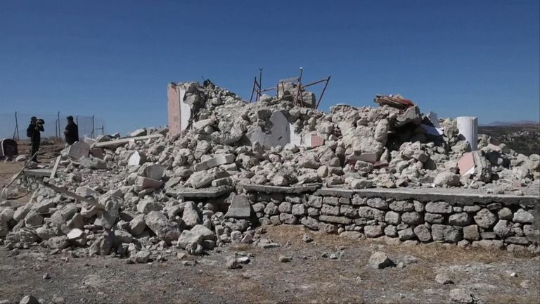 Damaged buildings and rubble in Crete, Greece.