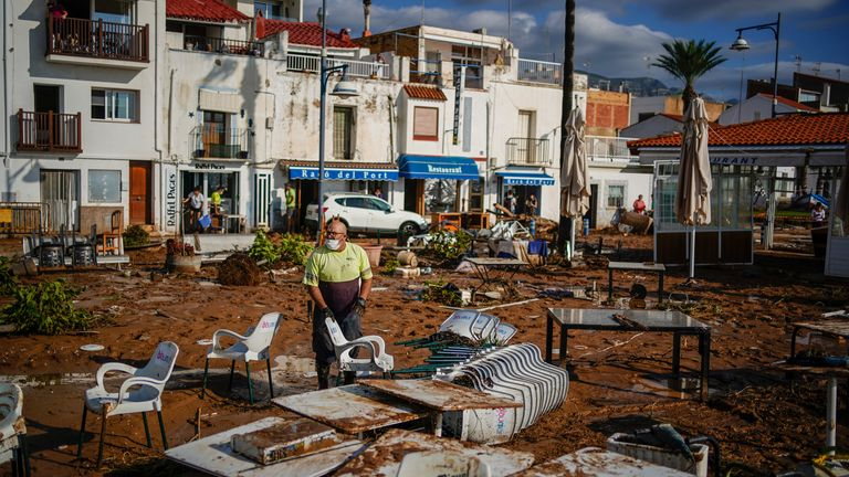 A municipality worker cleans up after flooding in a seaside town of Alcanar, in northeastern Spain, Thursday, Sept. 2, 2021 PIC:AP