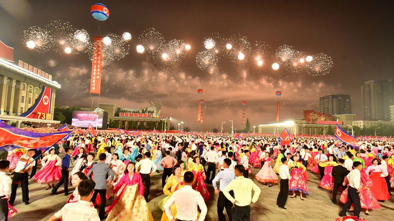 People dance during a paramilitary parade held to mark the 73rd founding anniversary of the republic at Kim Il Sung square in Pyongyang in this undated image supplied by North Korea's Korean Central News Agency on September 9, 2021. KCNA via REUTERS