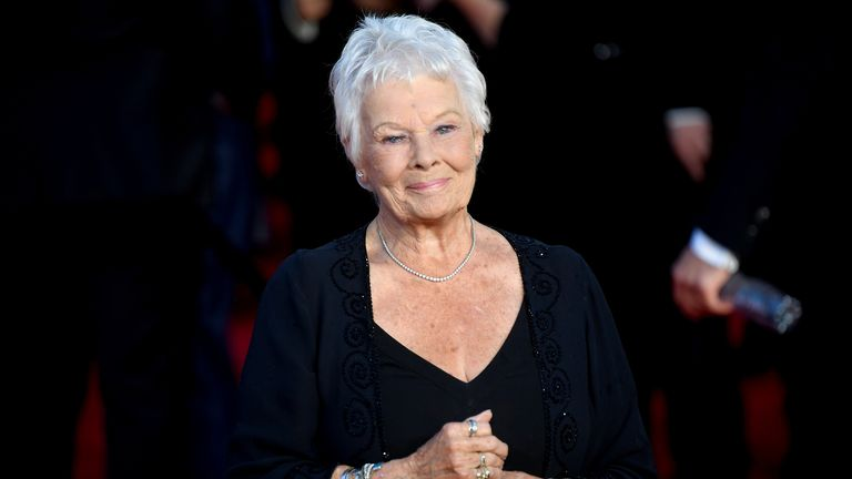 """Actor Judi Dench poses during the world premiere of the new James Bond film """"No Time To Die"""" at the Royal Albert Hall in London, Britain, September 28, 2021. REUTERS/Toby Melville"""