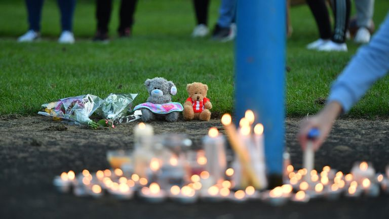 Flowers, soft toys and candles are seen at a vigil near to the scene in Chandos Crescent, Killamarsh