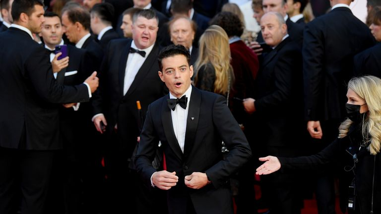 """Cast member Rami Malek reacts during the world premiere of the new James Bond film """"No Time To Die"""" at the Royal Albert Hall in London, Britain, September 28, 2021. REUTERS/Toby Melville"""