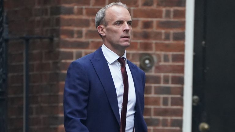 Dominic Raab walks down Downing Street after his sacking as foreign secretary