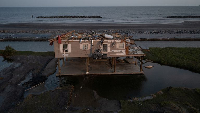 A house is seen damaged in the aftermath of Hurricane Ida as the Category 4 hurricane devastated the town and barrier island of Grand Isle, Louisiana, U.S., September 2, 2021. Picture taken with a drone. REUTERS