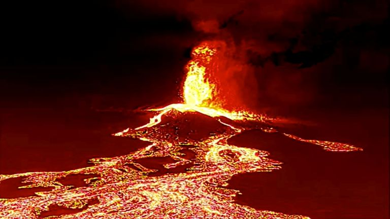 vScreen grab from a video taken by a night drone shows a volcano erupting and tongues of lava in La Palma, Spain September 22, 2021. Spanish Emergency Military Unit (UME)/
