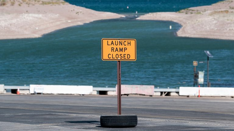 """A sign alerts boaters of the closure of the Boulder Harbor launch ramp due to low water levels at Lake Mead in Boulder City, Nev., on Monday, August 23, 2021. The Bureau of Reclamation declared a shortage on the Colorado River last week as the nation""""s largest resevoir fell to 35% of capacity.  PIC:AP"""