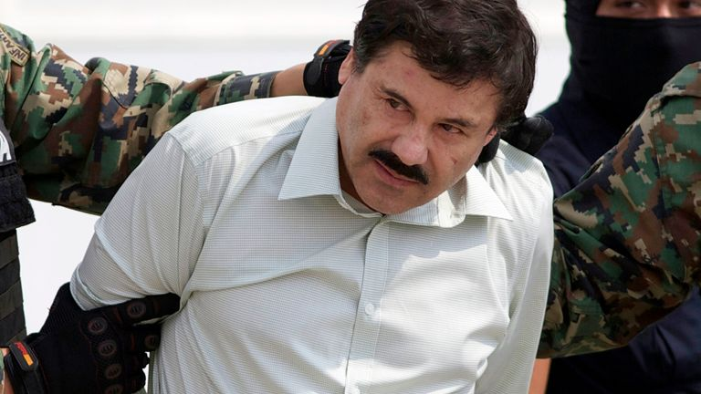 """FILE - This Feb. 22, 2014 file photo shows Joaquin """"El Chapo"""" Guzman, the head of Mexico's Sinaloa Cartel, being escorted to a helicopter in Mexico City following his capture in the beach resort town of Mazatlan. Attorneys for Guzman are asking for a new trial in light of what they say was jury misconduct during his drug conspiracy trial. (AP Photo/Eduardo Verdugo, File)"""