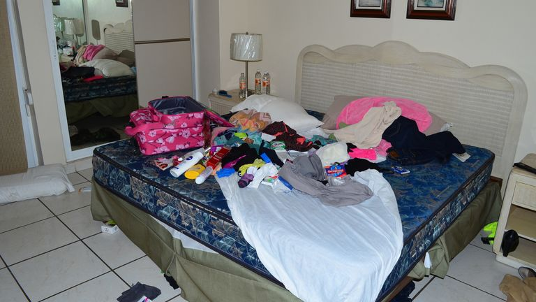 """Clothes and toiletries are scattered on a bed in a bedroom of a high-rise condominium where famed drug boss Joaquin """"El Chapo"""" Guzman was arrested, in Mazatlan, Mexico, Saturday Feb. 22, 2014. At the moment of his arrest, Guzman was found with an unidentified woman, said one official not authorized to be quoted by name, adding that the U.S. Drug Enforcement Administration and the Marshals Service were """"heavily involved"""" in the capture. No shots were fired. (AP Photo/El Debate de Mazatla"""