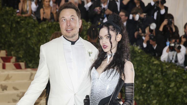 Elon Musk and Grimes, pictured her at the Met Gala in 2018, have split but are good terms