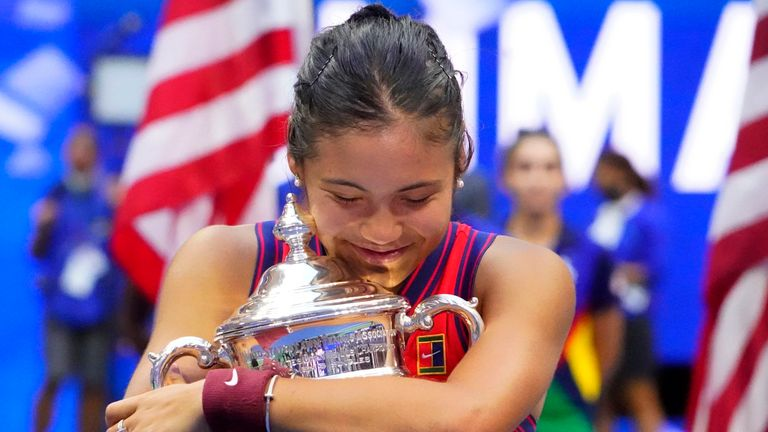 Emma Raducanu of Great Britain celebrates with the championship trophy after her match against Leylah Fernandez of Canada