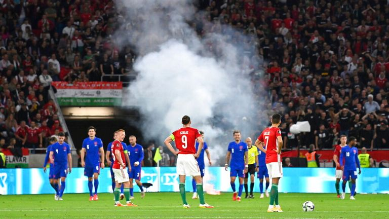 A flare was thrown onto the pitch as England scored their third goal on Thursday. Pic: AP