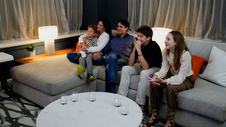 Canada's Liberal Prime Minister Justin Trudeau, accompanied by his wife Sophie Gregoire and his children Ella-Grace, Xavier and Hadrien watch the election coverage on a TV, in Montreal