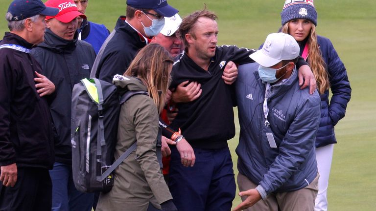 Golf - The 2020 Ryder Cup - Whistling Straits, Sheboygan, Wisconsin, U.S. - September 23, 2021 Actor Tom Felton receives medical attention during a practice round REUTERS/Mike Segar
