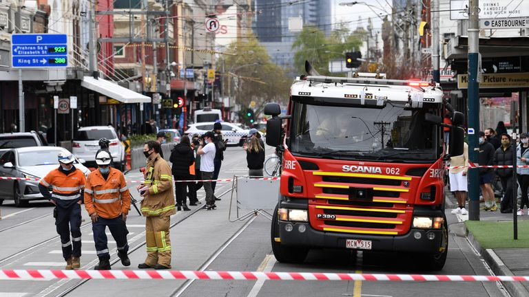 Emergency Services personnel respond to an area that sustained damage from an earthquake in the Windsor suburb of Melbourne, Australia