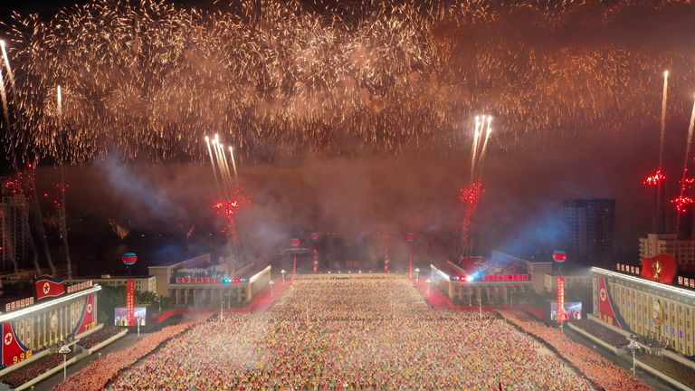 Fireworks go off during a paramilitary parade held to mark the 73rd founding anniversary of the republic at Kim Il Sung square in Pyongyang in this undated image supplied by North Korea's Korean Central News Agency on September 9, 2021. KCNA via REUTERS